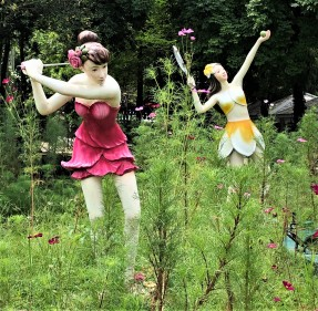 Golf-playing and tennis-playing flower fairies near the Sihuhata statue in 75 Anniversary and Flag Park, Chiang Rai, Thailand