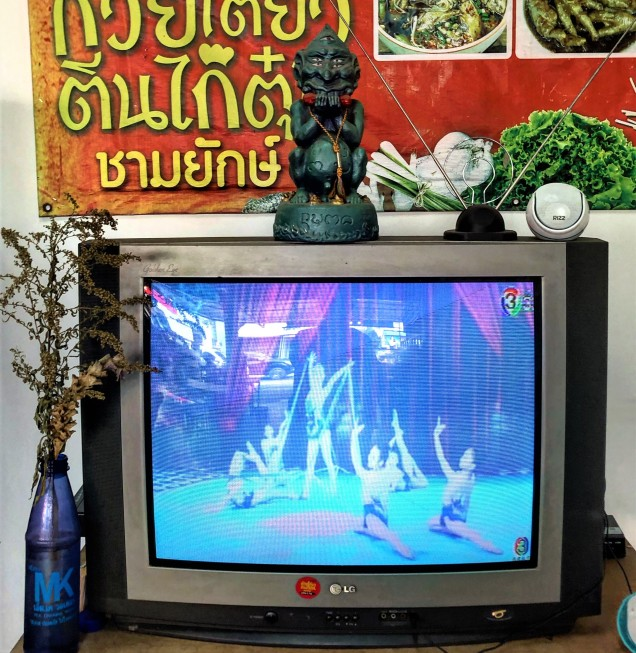 Sihuhata presides over a gymnastics show on TV at a local restaurant. Chiang Rai, Thailand.