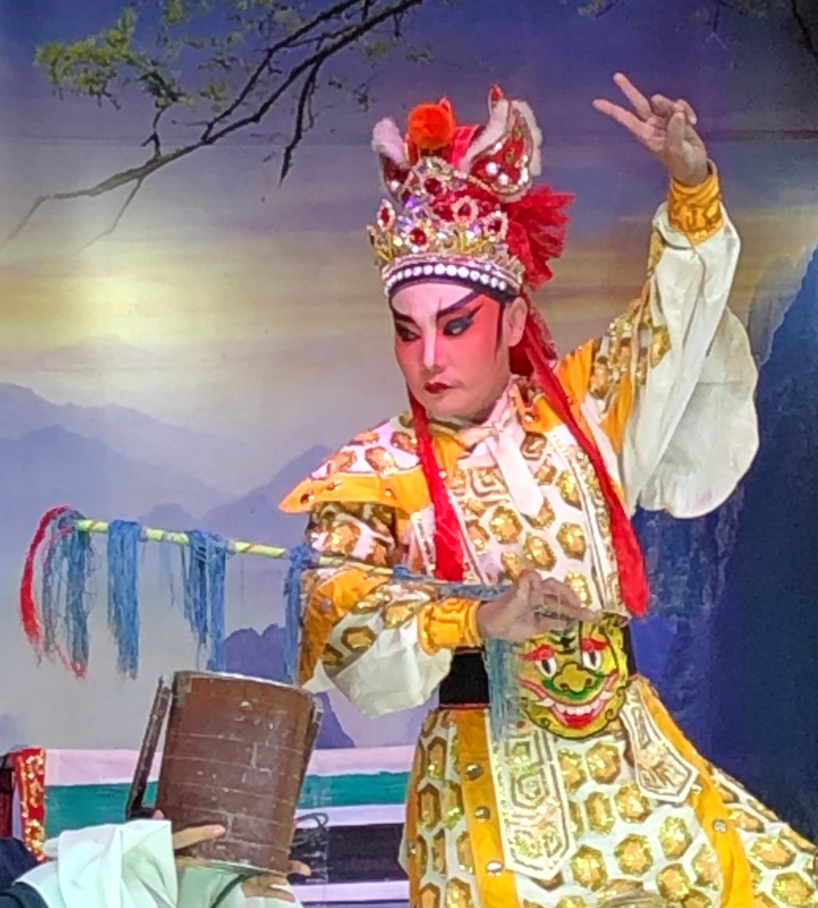 Chinese opera actor, Vientiane, Laos.  His makeup is like a mask, his gestures tell the story.