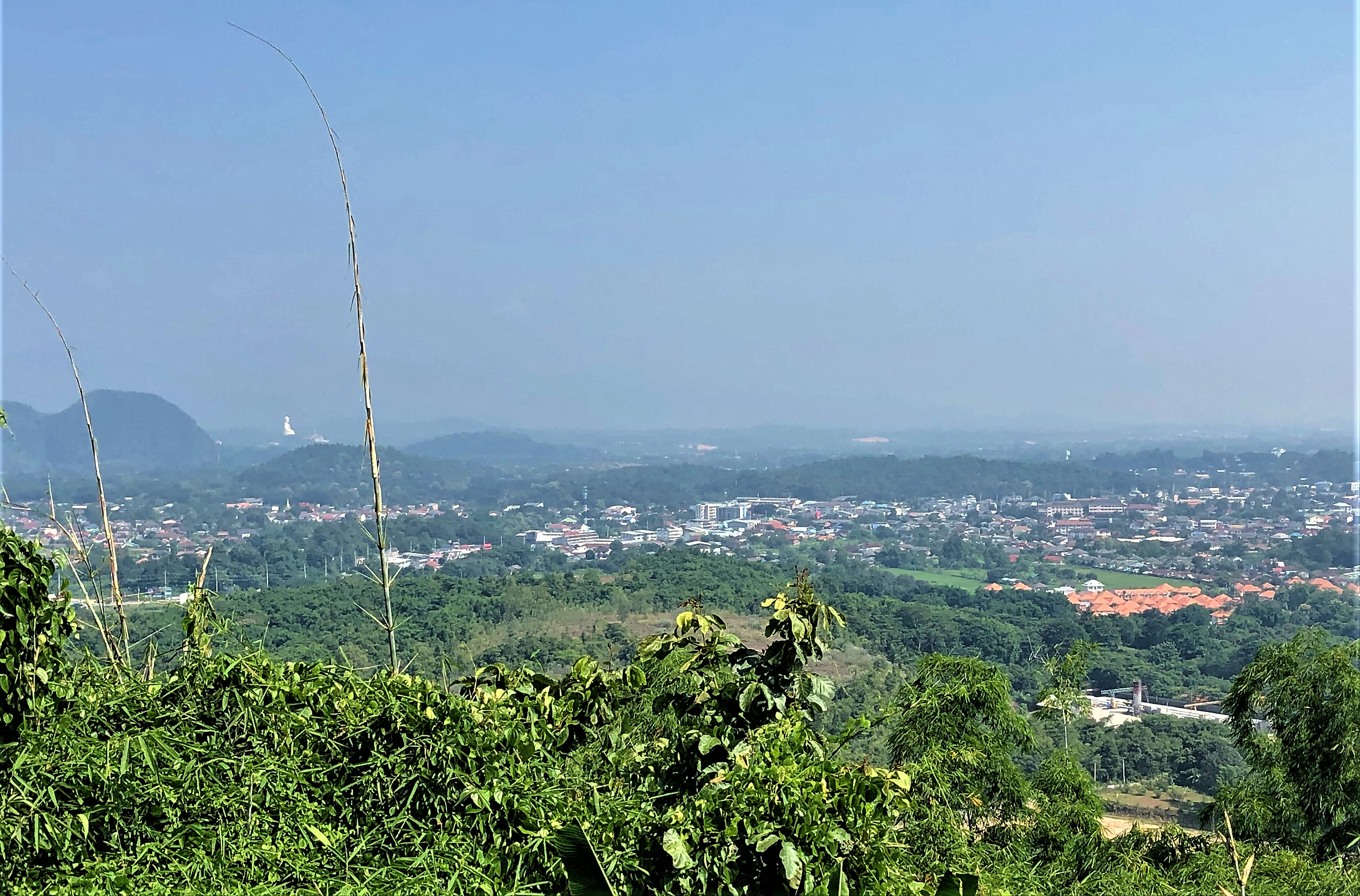The view of Chiang Rai and the mountains beyond from the new Sihuhata temple at Wat Phra That Doi Khao Kwai